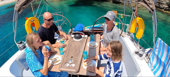 family enjoying their yacht charter holiday